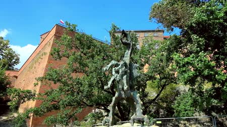wawel : The statue of Wawel Dragon (Smok Wawelski) stands in park on the Wawel Hill in front of the cave (Smocza Jama), located under the Wawel Castle, Krakow, Poland.