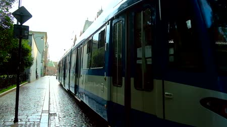 kamienice : KRAKOW, POLAND - JUNE 21, 2018: The tram rides along Dominikanska street in the hard rain, on June 21 in Krakow.