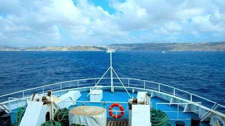 ferry terminal : GHAJNSIELEM, MALTA - JUNE 15, 2018: Enjoy the short ferry trip between Malta and Gozo Islands, watching the beautiful cloudscape, seascape and oncoming ferry, on June 15 in Ghajnsielem. Stock Footage