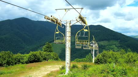 chairlift : The chairlift on the slope of Makovytsia Mountain, covered with green forest, Mizhhiria, Ukraine.