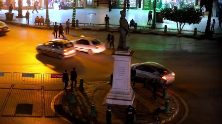 colonial : CAIRO, EGYPT - DECEMBER 23, 2017: People walks across the busy Talaat Harb square with driving cars, on December 23 in Cairo. Stock Footage