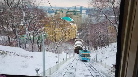 snowbound : KIEV, UKRAINE - DECEMBER 19, 2018: The best way to enjoy snowy winter day is to take a ride on Funicular tram and explore old town, on December 19 in Kiev