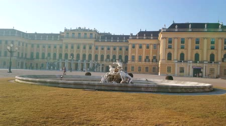 schonbrunn : VIENNA, AUSTRIA - FEBRUARY 19, 2019: The facade of Baroque style Schonbrunn Palace with outstanding Ehrenhof fountain (Ehrenhofbrunnen) on the foreground, on February 19 in Vienna.