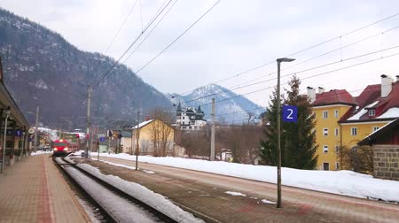 bahnhof : BAD ISCHL, AUSTRIA - FEBRUARY 21, 2019: The modern red train arrives to the Bad Ischl Railway station (Bahnhof), on February 21 in Bad Ischl.