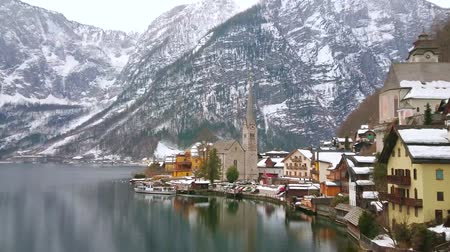 evangelical : The ferry departures from the port of Hallstatt - the old town located on the bank of Hallstatter see (lake) at the foot of Salzberg Mount, Salzkammergut, Austria.