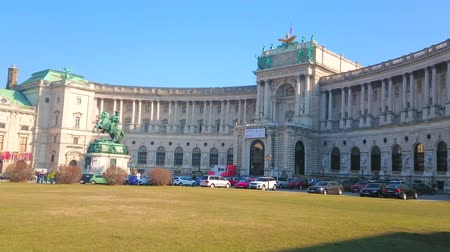 hofburg : VIENNA, AUSTRIA - FEBRUARY 17, 2019: Ensemble of Heldenplatz (Heroes square) with bronze equaestrian statue of Prince Eugene of Savoy and Neue Burg section of Hofburg palace, on February 17 in Vienna.