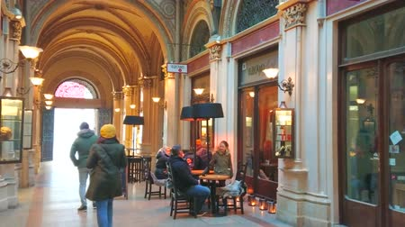 avusturya : VIENNA, AUSTRIA - FEBRUARY 17, 2019: The splendid interior of Freyung Passage of Ferstel palace, serving as the shopping arcade with cafes and bars, on February 17 in Vienna. Stok Video