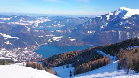 ski run : Idyllic nature of Salzkammergut with a view on Alpine scenery, Wolfgangsee valley, pine forests, St Gilden town and deep blue lakes of Wolfgangsee and Mondsee, Austria. Stock Footage