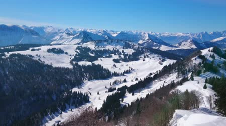 ski run : Panorama from Zwolferhorn mountain top with a view on Alpine scenery, pine forests, peak of Spielbergalm and Wolfgangsee lake on the background, St Gilden, Salzkammegut, Austria.