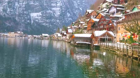 hallstatter see : Hallstatter see (lake) with old housing of Hallstatt, its lakeside promenade, port with wooden garages for boats and Alpine range on the background, Salzkammergut, Austria.