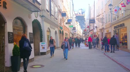 townhouse : SALZBURG, AUSTRIA - FEBRUARY 27, 2019: Nowadays Getreidegasse street serves as one of main tourist areas, offering shopping, visiting of popular cafes or historic landmarks, on February 27 in Salzburg