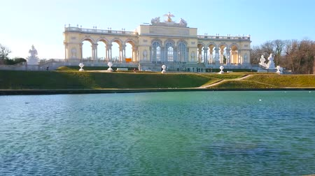 schonbrunn : VIENNA, AUSTRIA - FEBRUARY 19, 2019: The top point of Schonbrunn hill with picturesque Gloriette pavilion, small pond and greenery of Schlosspark (garden), on February 19 in Vienna.