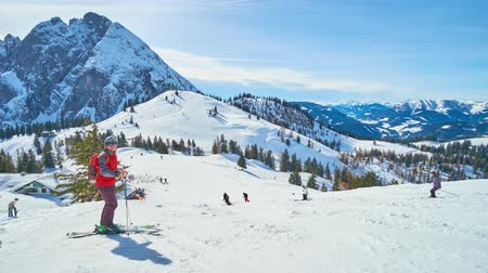 chairlift : GOSAU, AUSTRIA - FEBRUARY 26, 2019: The slopes of Zwieselalm mount Dachstein West Alps are popular among the skiers and boarders, visiting Salzkammergut resorts, on February 26 in Gosau. Stock Footage