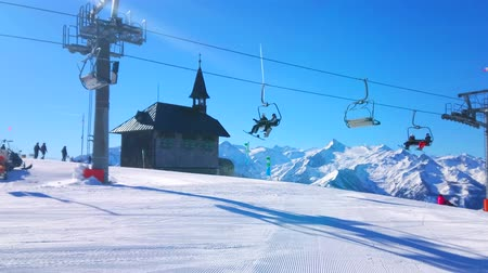 elisabeth : ZELL AM SEE, AUSTRIA - FEBRUARY 28, 2019: The fast riding ski lift in front of the Elisabeth chapel, located on the top of Schmitten mountain, on February 28 in Zell Am See.