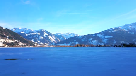 elisabeth : Enjoy the lakeside Elisabeth park with a view on Zeller see, covered with ice and surrounded by rocky Alps, Zell am See, Austria. Stock Footage