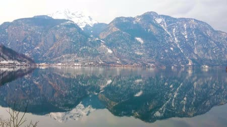 hegytömb : Enjoy the picturesque nature of Salzkammergut, walking by iconic Hallstattersee lake, surrounded by Dachstein Alps, Salzkammergut, Austria.