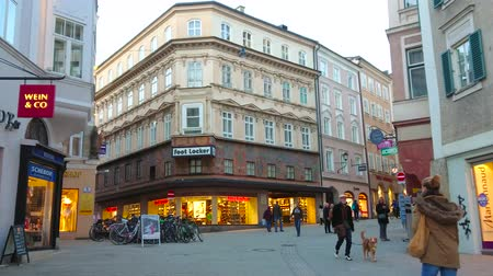 townhouse : SALZBURG, AUSTRIA - FEBRUARY 27, 2019: Walk along the evening Linzergasse street - one of the main shopping areas of the city, on February 27 in Salzburg.