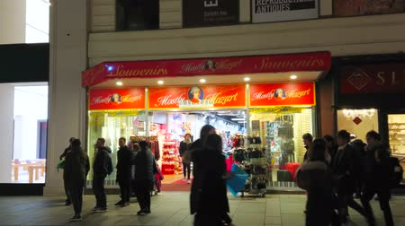 mozart : VIENNA, AUSTRIA - FEBRUARY 18, 2019: The brightly illuminated showcase of Mostly Mozart souvenir store, offering large amount of different gifts, located in Karntnerstrasse, on February 18 in Vienna.