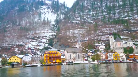 evangelical : HALLSTATT, AUSTRIA - FEBRUARY 21, 2019: The ferry trip is the best chance to watch Hallstatt from Hallstattersee lake, enjoy its cityscape, Dachstein mountains and nature, on February 21 in Hallstatt