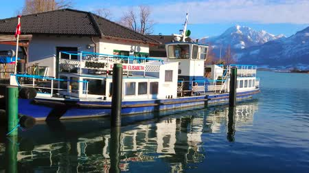 avusturya : ST WOLFGANG, AUSTRIA - FEBRUARY 23, 2019: The vintage Kaiserin Elisabeth ferry is moored in port on Wolfgangsee lake, on February 23 in St Wolfgang.