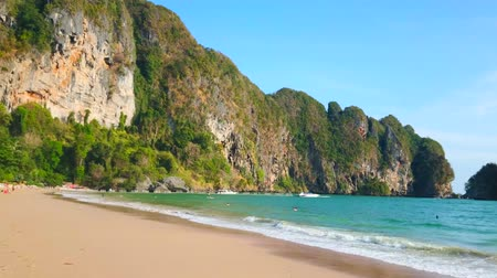 aonang : Panorama of the Ao Nang coast from the Monkey beach, lined with jungle and huge limestone rock formations, Krabi, Thailand