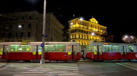 streetlights : VIENNA, AUSTRIA - FEBRUARY 18, 2019: The evening in city with a view on modern tram, turning to the Karntner Ring avenue from the Schwarzenberg Square, on February 18 in Vienna.
