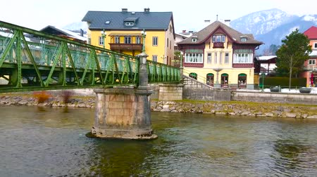 townhouse : The Taubersteg pedestrian bridge connects the banks of Traun river, lined with old scenic villas, Bad Ischl, Salzkammergut, Austria.