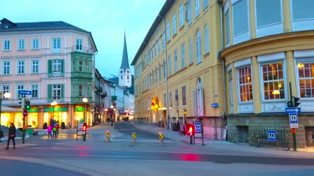evangelical : BAD ISCHL, AUSTRIA - FEBRUARY 20, 2019: The colorful dense buildings of Pfarrgasse street in dimmed evening city lights, on February 20 in Bad Ischl