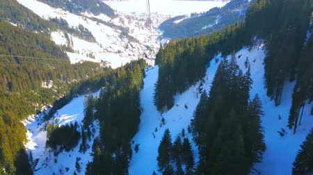 frozen lake : Fantastic Alpine scenery from the tram of modern Schmittenhohenbahn cableway, overlooking mountains of Zell am See resort, Austria. Stock Footage