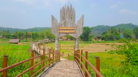 poo : Gate of Su Tong Pae Bamboo Bridge with inscription of its name - Bridge of Faith and Success; this construction stretches along the paddy fields of local villagers, Mae Hong Son suburb, Thailand