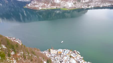 hegytömb : Aerial view on clear surface of Hallstattersee lake and floating ferry from the Salzberg mountain top, Halstatt, Salzkammergut, Austria.