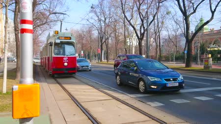 stadtpark : VIENNA, AUSTRIA - FEBRUARY 18, 2019: The vintage red tram drives along the Parkring of Ringstrasse road, on February 18 in Vienna