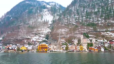 evangelical : HALLSTATT, AUSTRIA - FEBRUARY 25, 2019: The boat trip along Hallstattersee lake is best choice to observe the old town with its traditional architecture, on February 25 in Hallstatt. Stock Footage