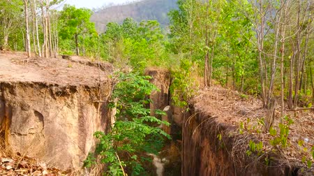 geological feature : Explore Pai land split - the crack in ground, located in mountains and formed by seismic activity and earthquakes, Thailand
