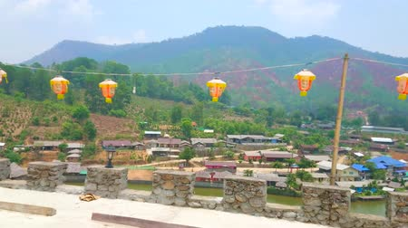 faroles chinos : Panorama of Ban Rak Thai (Mae Aw) Yunnan tea village from the fortress wall, decorated with hanging Chinese lanterns, Thailand