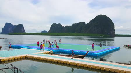 sudeste : KO PANYI, THAILAND - APRIL 28, 2019: Floating football pitch is notable landmark of Ko Panyi (Koh Panyee) island, its popular among tourists, visiting Muslim fishing village, on April 28 in Ko Panyi