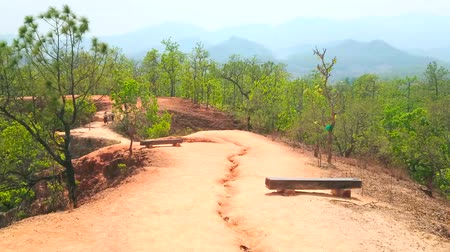 erozyon : The footpath stretches along adobe red cliff of Pai Canyon (Kong Lan), surrounded by forest, Thailand