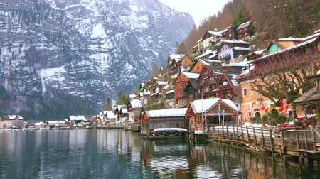 hegytömb : The old wooden snowy houses of Hallstatt and rocky slopes of Dachstein Alps are reflected on mirror surface of clear Hallstatter see (lake), Salzkammergut, Austria