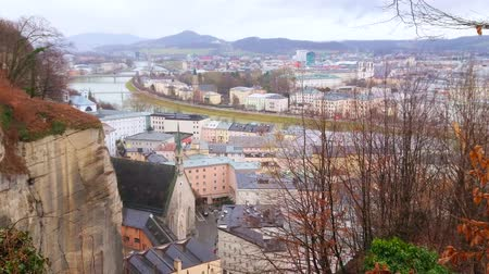 picturesque quarters : Picturesque cityscape of Salzburg from the top of Monchsberg Hill, observing old town quarters, Salzach river and St Blasius Hospital Church (Burgerspitalkirche), one of the oldest in city, Austria
