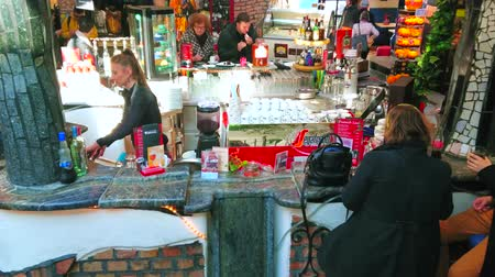avusturya : VIENNA, AUSTRIA - FEBRUARY 19, 2019: The lounge zone of Hundertwasser Village with interesting stone bar counter, decorated with narrow fountain, making air fresh and cool, on February 19 in Vienna