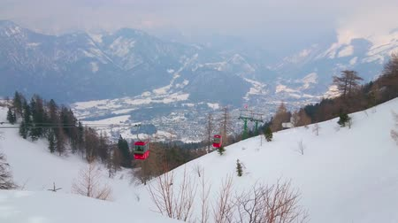 hegytömb : The Mount Katrin overlooks foggy valley of Bad Ischl, riding vintage gondolas of cable car and snowy slopes of Dachstein Alps, Salzkammergut, Austria.