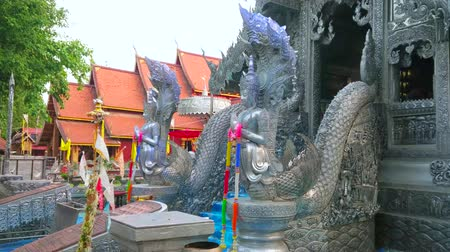 ganesha : CHIANG MAI, THAILAND - MAY 4, 2019: The porch of stunning Silver Temple (Wat Sri Suphan) with Naga serpents guardians, made of silver, on May 4 in Chiang Mai