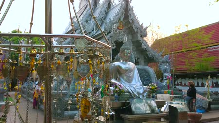 ganesha : CHIANG MAI, THAILAND - MAY 4, 2019: The metal prayer leaves (Bo, Bodhi tree) in front of Buddha Image and ornate Silver Temple (Wat Sri Suphan), on May 4 in Chiang Mai
