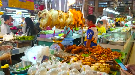 bazar : CHIANG MAI, THAILAND - MAY 4, 2019: The stall of Tanin market food section offers smoked spicy chicken, char grilled and deep fried pork,  on May 4 in Chiang Mai