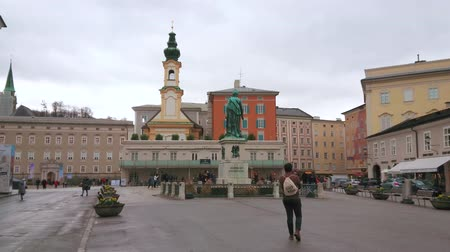 mozart : SALZBURG, AUSTRIA - MARCH 1, 2019: The Mozart square (Mozarplatz) is historical landmark, here is located Monument to Mozart and St Michael church (Michaelskirche), on March 1 in Salzburg.