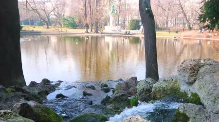 stadtpark : The tiny waterfall in Stadtpark (City park) of Vienna with a view on lake, winter trees and mallards, Austria