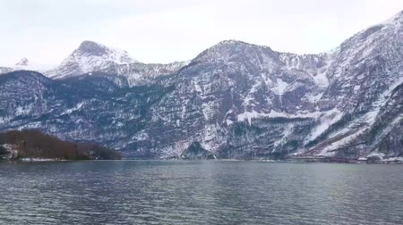 hallstatter see : Hallstatter see (lake) is surrounded by huge Dachstein Alps, covered with snow, Salzkammergut, Austria