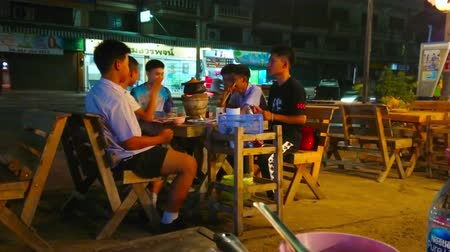kookgerei : LAMPANG, THAILAND - MAY 8, 2019: The group of teens prepares Thai soup in clay pot with charcoal stove in outdoor self cooking restaurant, on May 8 in Lampang