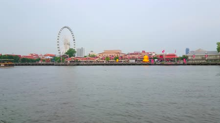 siamês : The boat trip along Asiatique The Riverfront shopping mall with sculpture of giant yellow duck, ferris wheel of luna park and modern skyscrapers, on May 15 in Bangkok
