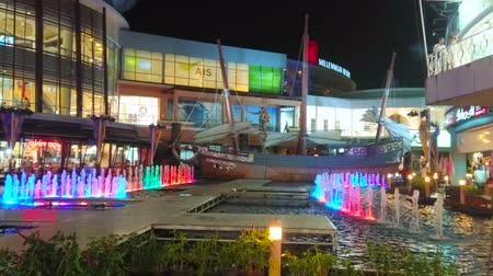 binnenhof : PATONG, THAILAND - MAY 1, 2019: The colorful lighting fountain and vintage wooden ship decorate the courtyard of Jungceylon Shopping Center, popular among the tourists of Phuket, on May 1 in Patong